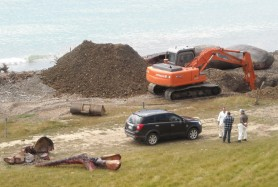 Burying a sperm whale washed up north of Kaikoura. The lower jaw, lower left, put aside for cultural uses.